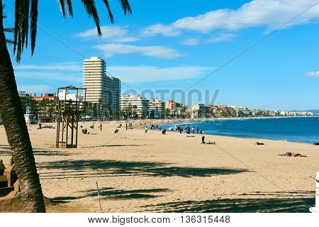 Peniscola Spain- March 27 2016: People relaxing on the Peniscola beach. Costa del Azahar province of Castellon Valencian Community. Spain