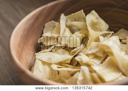 Dried bananas Thai snack in wooden bowl