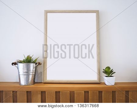 Mock up Poster Wooden Frame with Plants Hipster Home decoration Background