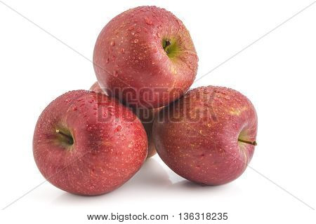 Bunch of raw organic braeburn apples isolated on white background