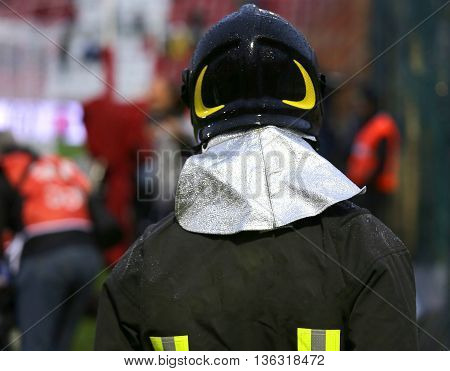 Firefighter With Helmet For The Security Service In The Stadium During The Sporting Event