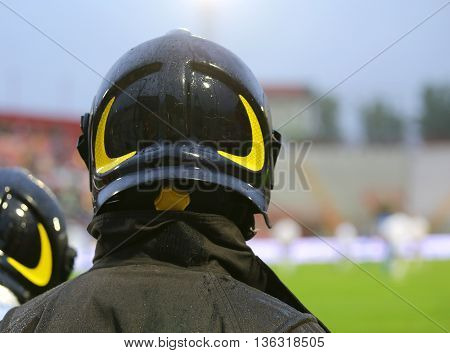 Firefighter With Helmet For The Security Service During The Sporting Event