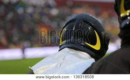Firefighter With Helmet For The Security Service In The Stadium
