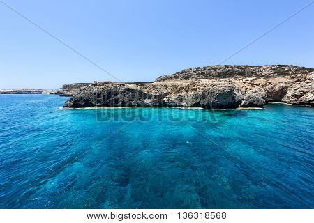 Pirate bay in protaras paralimni, blue sea, immaculate water and rocks, cyprus island