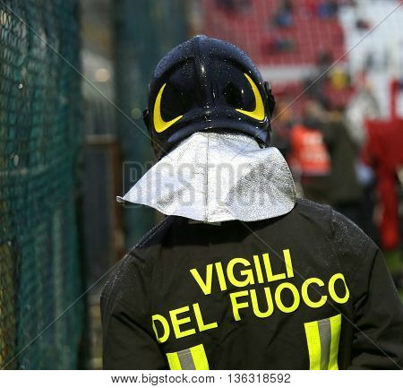 Italian Firefighter With Uniform With The Inscription Firefighters In The Stadium During The Sportin