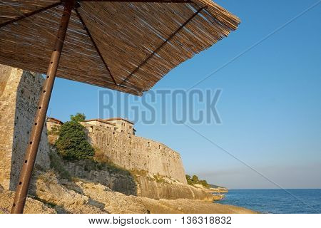 view Ulcinj Stari Grad fortified wall under sunshade, Montenegro