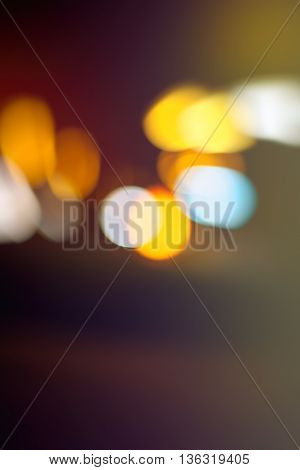 Traffic light bokeh as background vehicle headlights out of focus retro toned