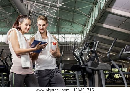 Man talking to trainer after a workout at gym