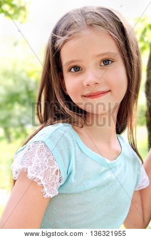Adorable smiling little girl in summer day outdoor
