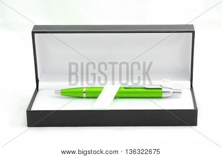 A green pen in luxury box on the white background