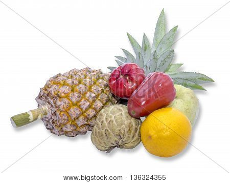 Mix colorful asian fruits of pineapple orange custard custard apple rose apple guava on isolated / white background