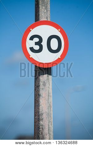 Color image of a 30km/h speed restriction road sign.