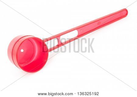 Red measuring spoon
