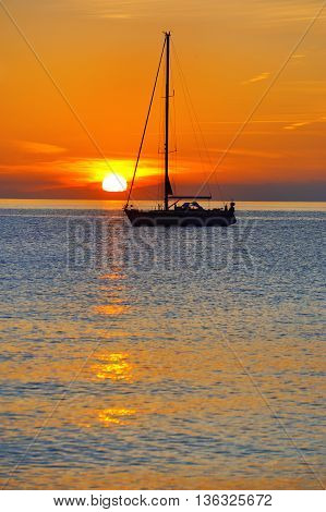 Sea red sunset landscape with yacht silhouette