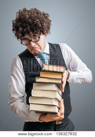 Funny Nerd Man Holds Many Books In Hands.