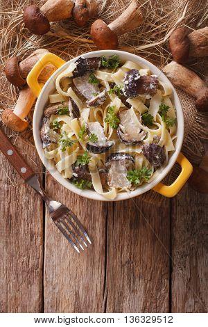 Pasta Fettuccine With Wild Mushrooms In Cream Sauce Closeup In A Pot. Vertical Top View