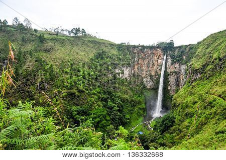 SUMATRA, INDONESIA - 23 MAY 2015 : Famous Sipiso Piso Waterfall in spring in Northern part of the Sumatra Indonesia