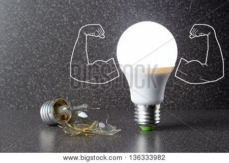 Led Bulb And Broken Incandescent Lamp