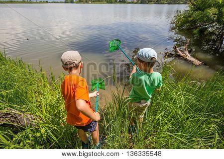 Two boys having fun with fishing nets