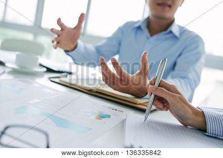 Business executive explaining his idea to colleague