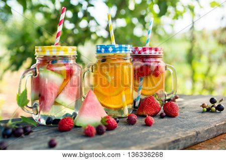 Ice refreshing summer drink with of different fruits and berries