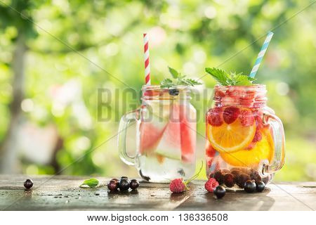 Ice refreshing summer drink on blurred background.