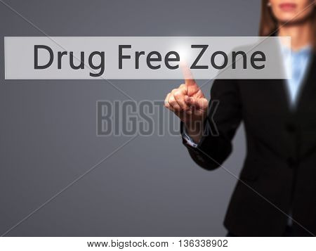 Drug Free Zone - Businesswoman Hand Pressing Button On Touch Screen Interface.