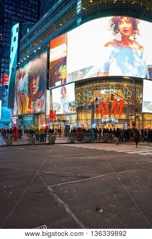 NEW YORK - CIRCA MARCH 2016: Times Square H&M store at night. H & M Hennes & Mauritz AB is a Swedish multinational retail-clothing company, known for its fast-fashion clothing.