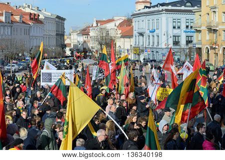 VILNIUS, LITHUANIA - MAR 11: Around one thousand people gathered with flags in a nationalist rally at Rotuses Square on Re-Establishment of Independence Day on March 11, 2014 in Vilnius, Lithuania