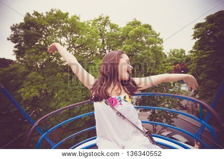 happy teen girl on panoramic wheel summer day