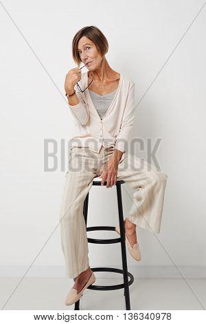 Portrait of senior woman sitting on chair