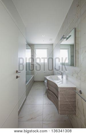 empty apartment, open door of the bathroom, interior