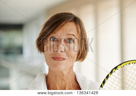 Face of senior female badminton player looking at camera