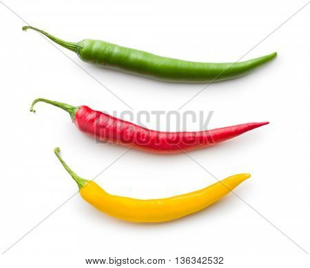 Different colors chilli peppers isolated on white background.
