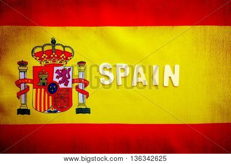 Spanish flag, yellow and red cloth with national Spain emblem, text space, grunge style patriotic wallpaper, background for football fans