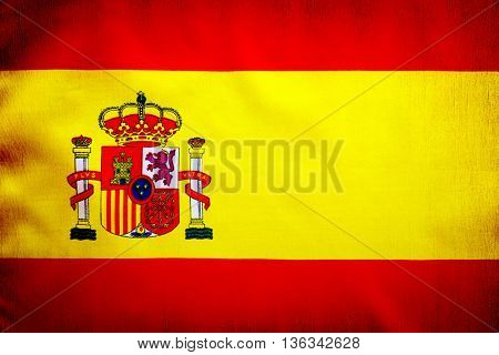 Spanish flag, yellow and red cloth with national Spain emblem, grunge style patriotic wallpaper