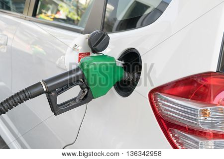 Fuel nozzle to add fuel in car at gas station