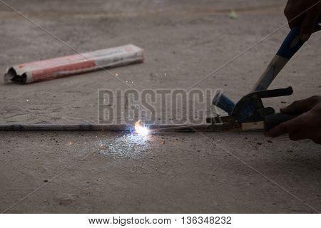 Welder working a welding metal. Not wearing glove