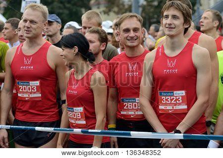 VILNIUS LITHUANIA - SEPTEMBER 14: Runners on start of 11th Danske Bank Vilnius Marathon on 14 September 2014 in Vilnius Lithuania. Vilnius Marathon became a member of AIMS in 2007.