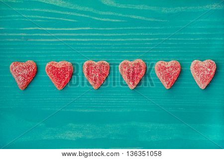 Valentines day candy hearts. Red,  sugar, on wooden  turquoise table. Background. Copy space