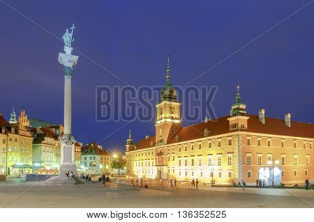 The Royal Castle and the Column of King Sigismund the Old City at night. Warsaw. Poland.