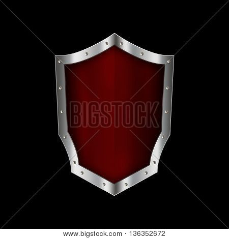Ancient red shield with silver riveted border on black background.