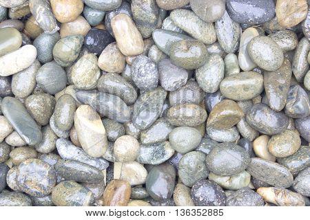 pebble stones background. closeup of stones texture