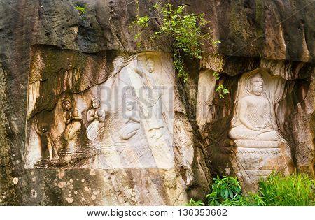 Sculptures of Buddha on sandstone THAILAND .