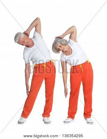Portrait of senior couple exercising on a white background