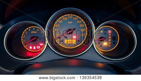 Modern car illuminated dashboard closeup. car, door, key,