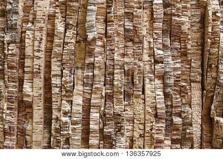 Laminated and stacked natural corks bark. Horizontal