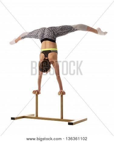 Gymnastics. Flexible girl doing handstand on circus stands