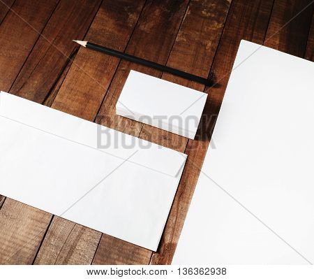 Close-up of blank corporate ID template on wooden table background. Responsive design template.