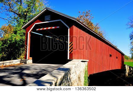 upper leacock township pennsylvnia - october 19 2015: 1867 single span. burr truss pinetown covered bridge over the conestoga river *